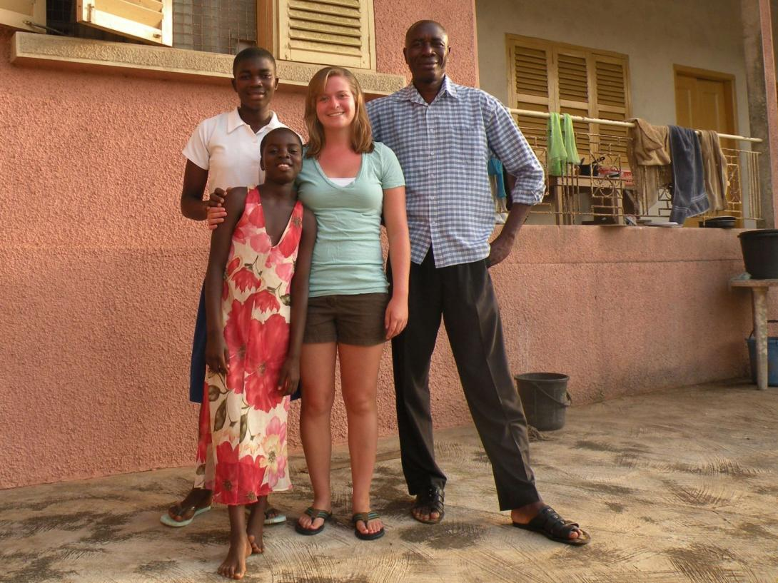 A care volunteer with her Ghanaian host family